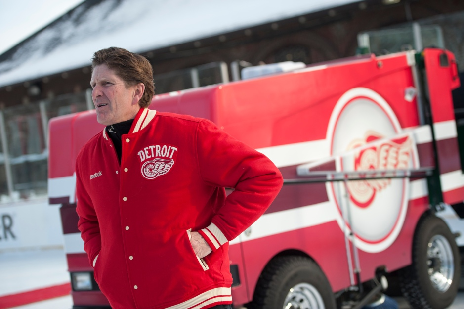 "(CAPTION INFORMATION) Red Wings head coach Mike Babcock hangs out on the rink near the newly donated Zamboni.            Photos are of an event at Clark Park in Detroit, December 16, 2013.  The NHL and the Detroit Red Wings unveiled a ""Winter Classic Legacy Initiative"" that will bring improvements to the ice rink including a new Zamboni and ice plant upgrades.   (The Detroit News / David Guralnick)"